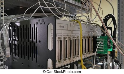 Network panel, switch and cable in data center.