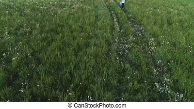 mother and son in field - mother and son in green field