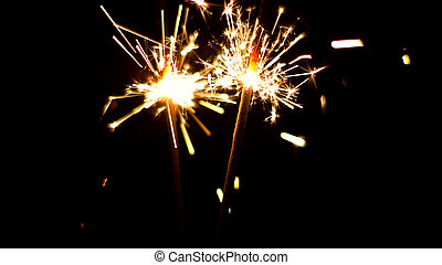 Burning Sparklers. Christmas and New Year lights. - Burning...