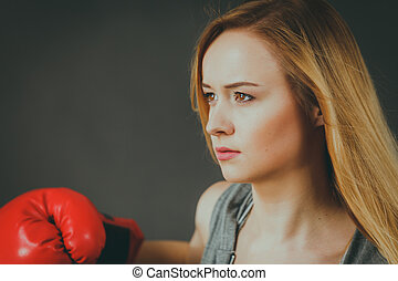 Beautiful woman with red boxing gloves