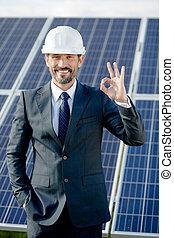 Solar panel energy choice of businessman.
