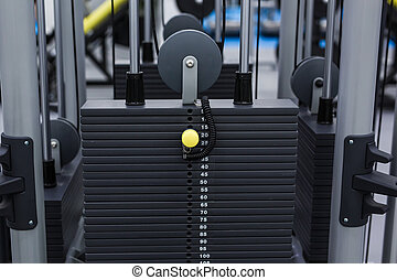 Black iron heavy plates stacked of weight machine in fitness...