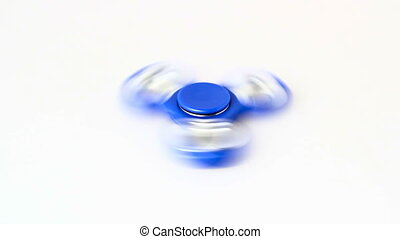 Fidget spinner isolated over white with spinning motion blur...