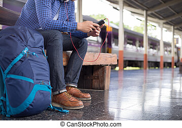 man traveler with backpacker listening to music at...