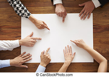 Human hands pointing at empty white card