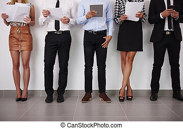 Human legs of people which waiting for job interview