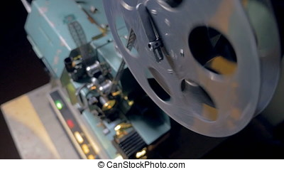 Film tape going through film projector. - Old-fashioned...