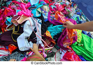 Fashion clothes bargain sale woman hands picking stacked...