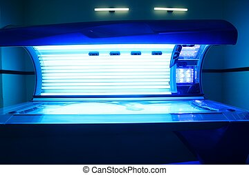 Tanning solarium light machine blue color glowing