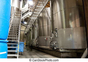 Wine Vats - Large stainless steel vats of wine inside of a...