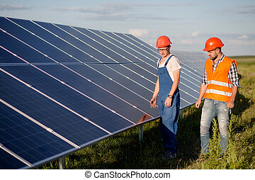 View on photovoltaic panels of solar power station. Foreman...