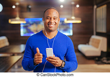 young attractive man with headphones and mobile phone...