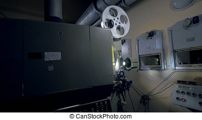 Obsolete mechanical film projector working. - Old-fashioned...