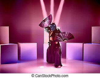 The modern ballet dancer as samurai on red studio background