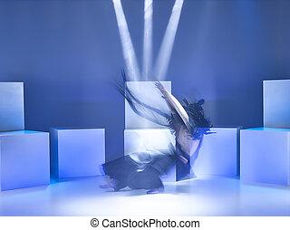 The modern ballet dancer as samurai on blue studio...