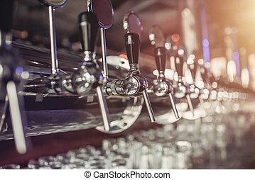 Beer taps in pub