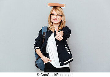 Student with book on head - Happy Female nerd in funny...