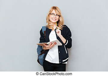 Smiling student with notebook - Smiling student in glasses...