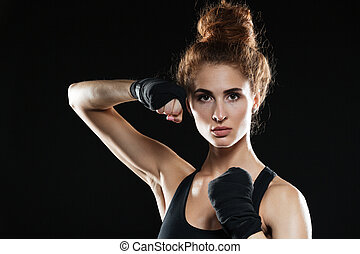 Close-up portrait of Concentrated female fighter ready to fight
