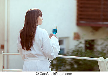 Woman is resting. - Woman is resting on the veranda with a...