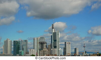 City business build cloud - Fluffy white clouds reflect in...