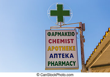 Pharmacy sign in different languages - Pharmacy sign on the...