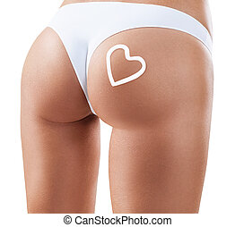 Woman applying moisturizer cream on buttocks. Anti-cellulite...