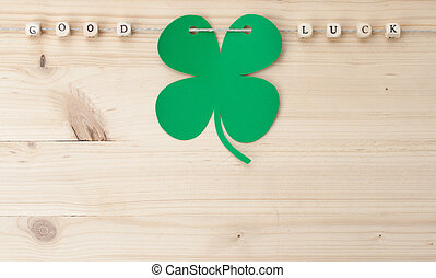 Good Luck - The words Good Luck and a cloverleaf on a cord...