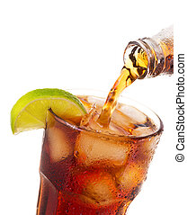 pouring cola into glass with ice and lime from bottle...
