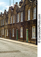 Typical English architecture, residential buildings in a row along the street