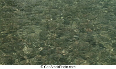"Clear water of lake ""Lago Epuyen"" - Close up view of clear..."