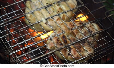 Grilled meat on the flaming grill - Barbecue with delicious...