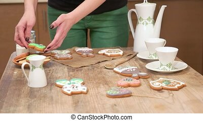 A woman in the kitchen puts out cookies