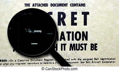Magnifying glass on secret document