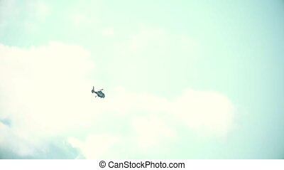 Super slow motion shot of a flying helicopter