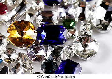 Crystal strasses - Large crystal strasses on a white...