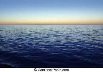 Beautiful sunset sunrise over blue sea ocean red sky -...