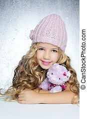 winter fashion cap little girl hug teddy bear smiling silver...