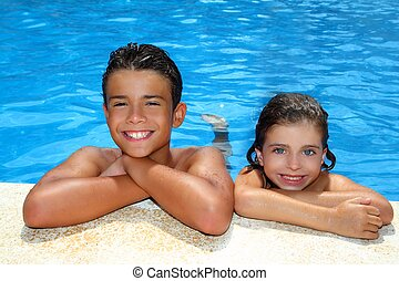 teen boy and little girl summer vacation in blue pool - teen...