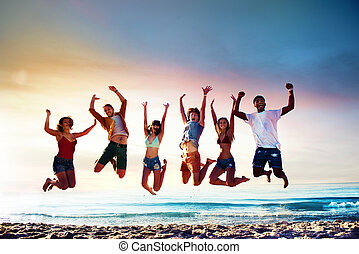 Happy smiling friends jumping at the beach - Happy smiling...