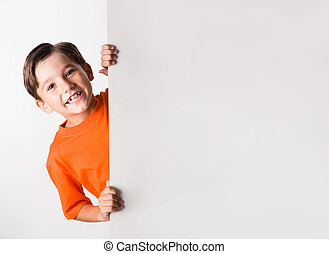 Fun - Image of laughing lad looking from behind white...