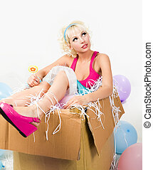 Doll in the box - Image of pretty young girl sitting inside...
