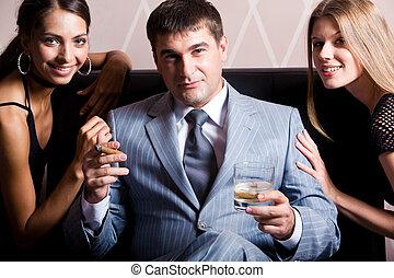 Rich man - Portrait of handsome man in grey suit sitting...