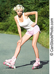 At leisure - Portrait of slim teenager wearing pink roller...