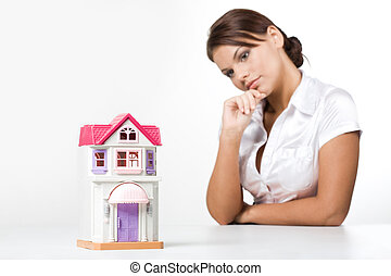 House model - Image of miniature toy house with pensive...