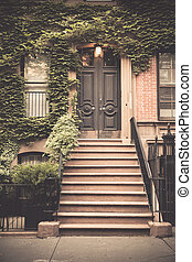 nyc brownstone - Ivy covered exterior door on New York City...