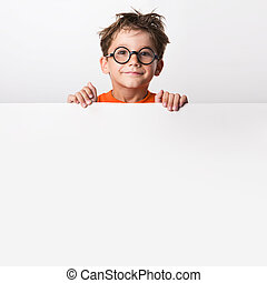 Cute infant - Photo of positive schoolkid behind partition...