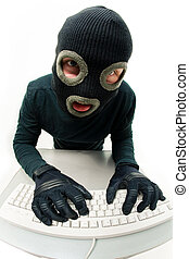 Hacker - Image of criminal in balaclava pressing buttons of...