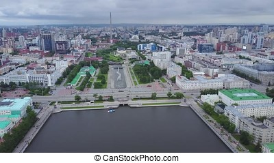 Bird's eye view of city, modern buildings, city river. Beautiful city aerial view