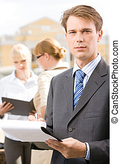 Serious boss - Photo of confident man looking at camera in...